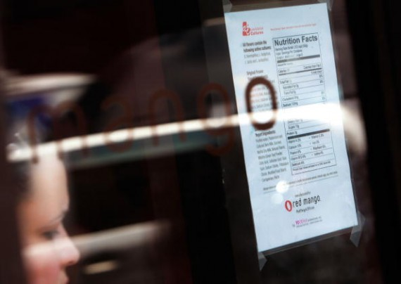 A nutritional chart is posted in the window of a Red Mango restaurant in New York City.