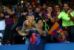 Daniel Alves of Barcelona takes a selfie with fans at the UEFA Champions League Finals.