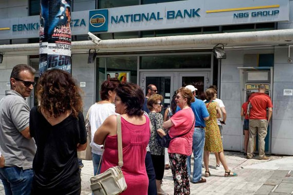 Greeks lined up to withdraw money from ATMs following the government's announcement of capital controls.