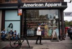 American Apparel will close stores and layoff people as part of its restructuring plan.