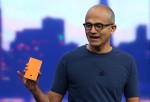 Microsoft CEO Satya Nadella with a Nokia phone.