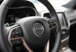MIAMI, FL - JULY 24: The interior of a Fiat Chrysler Jeep Grand Cherokee is seen on a sales lot as the company announced it is recalling about 1.4 million Dodges, Jeeps, Rams and Chryslers vehicles equipped with certain radios on July 24, 2015 in Miami, F