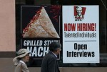 SAN FRANCISCO, CA - JULY 02: Pedestrians walk by a 'now hiring' sign at a KFC restaurant on July 2, 2015 in San Francisco, California. According to a report by the U.S. Labor Department, employers added 223,000 jobs in June dropping the national unemploym