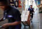 NEW YORK, NY - AUGUST 07: FedEx employees make deliveries in Manhattan on August 7, 2015 in New York City. In numbers released today by the Labor Department, nonfarm payrolls increased 215,000 last month as a pickup in manufacturing and construction jobs