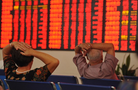 AUGUST 10: (CHINA OUT) Investors observe stock market data at a stock exchange hall on August 10, 2015 in Fuyang, Anhui Province of China