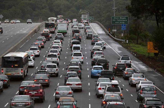 - DECEMBER 03: Cars sit in miles-long traffic jam on southbound highway 101 as they approach a flooded section of the freeway on December 3, 2014 in Mill Valley, California.