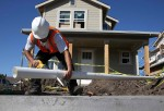 PETALUMA, CA - JANUARY 21: A worker cuts a piece of pipe as he builds a new home on January 21, 2015 in Petaluma, California.