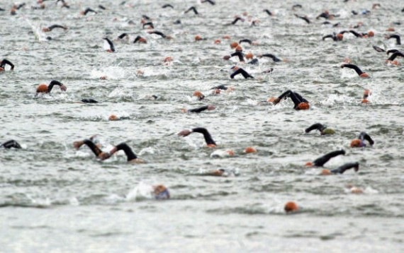 AUGUST 22: Swimmers cross the lake during the Ironman Triathlon at Sherbourne castle on August 22, 2004 in Dorset, England.