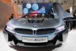 BEIJING, CHINA - APRIL 23: Visitors look at a BMW i 8 concept car is displayed during the media day of the 2012 Beijing International Automotive Exhibition at beijng International Exhibition Center on April 23, 2012 in Beijing, China.