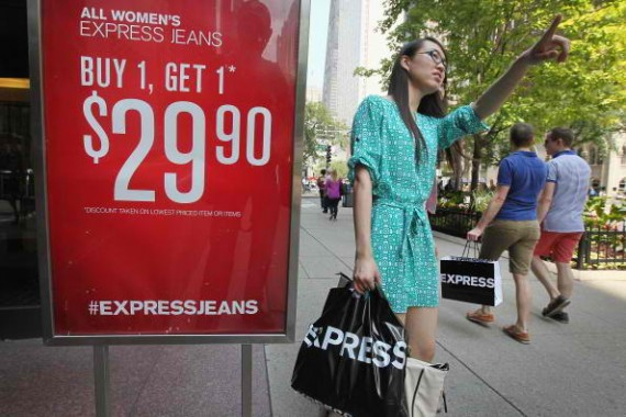 CHICAGO, IL - JULY 29: Shoppers visit stores along a section of Michigan Avenue known as the Magnificent Mile on July 29, 2014 in Chicago, Illinois