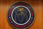 WASHINGTON, DC - FEBRUARY 26: The seal of the Federal Communications Commission hangs inside the hearing room at the FCC headquarters February 26, 2015 in Washington, DC.