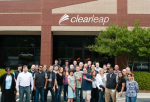 employees stand outside a Clearleap facicity