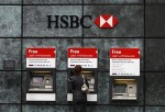 A woman using an HSBC ATM in London