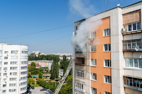 fire on the balcony of a multi-storey building